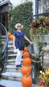 Savannah on stairs with pumpkins